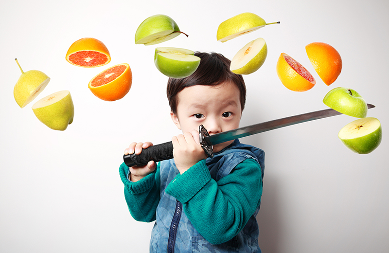 Cute asia children cut fruit